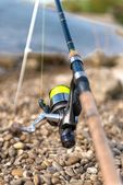 Modern clean fishing rod outdoors — Stock Photo