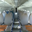 Interior of an airplane with many seats — Stock Photo #62646665