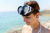 Scuba diver vrouw zien niet als gevolg van zon — Stockfoto