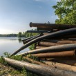 Rusty metal pipes in the forest — Stock Photo #68224723