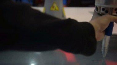 Robotic arm closeup photo writing automation — Stock Video