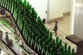 Many bottles on conveyor belt — Stock Photo