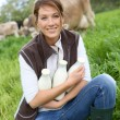 Breeder woman holding bottles of milk — Stock Photo #53234461
