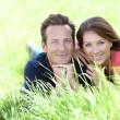 Couple laying in country field — Stock Photo #53234755