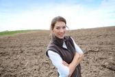 Farmer woman on farming land — Stock Photo
