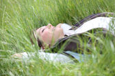 Woman relaxing in country field — Stock Photo