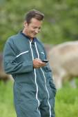 Farmer with smartphone — Stock Photo