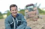 Smiling farmer in cultivated land — Stock Photo