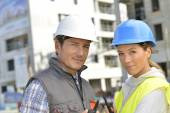 Construction team on building site — Stock Photo
