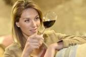 Woman tasting red wine in cellar — Stock Photo