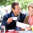 Couple at coffee shop with tablet — Stock Photo