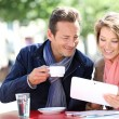 Couple at coffee shop with tablet — Stock Photo #53289259