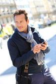 Trendy man using smartphone — Stock Photo