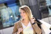 Woman with shopping bags in town — Stock Photo