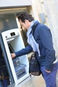 Man withdrawing money from ATM machine — Stock Photo