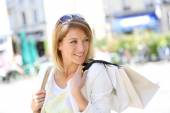 Woman doing shopping in town — Stock Photo