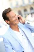 Mature man talking on phone — Stock Photo