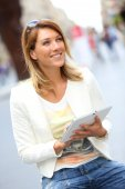 Woman using tablet in street — Stock Photo