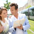 Couple looking at public transport map — Stock Photo #53290009