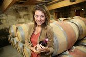 Woman holding bottle of wine — Stock Photo