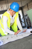 Woman architect using tablet — Stock Photo