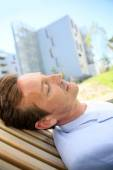 Man relaxing in public park — Stock Photo