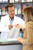 Veterinarian giving medical advice to client — Stock Photo