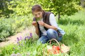 Woman smelling aromatic herbs — Stock Photo