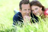Couple laying in country field — Stock Photo
