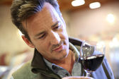 Winemaker tasting red wine in cellar — Stock Photo