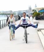 Couple riding bikes in Bordeaux — Stock Photo