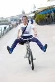 Man having fun riding bicycle — Stock Photo
