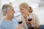 Senior couple drinking red wine — Stock Photo