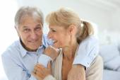 Senior man embracing his wife — Stock Photo