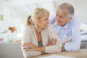 Couple at home filling pension paper — Stock Photo
