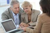 Couple meeting financial adviser — Stock Photo