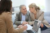 Couple meeting real estate agent — Stock Photo