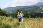 Senior people hiking — Stock Photo