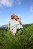 Senior couple walking in countryside — Stock Photo