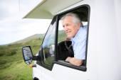 Man sitting by steering wheel — Stockfoto