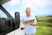 Senior man websurfing on tablet — Stock Photo