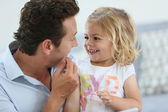 Daddy with girl having fun — Stock Photo