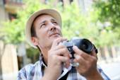 Photographer shooting with vintage camera — Stock Photo