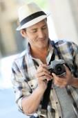 Photographer doing photo reportage — Stock Photo