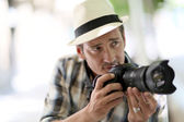 Professional photographer taking pictures — Stock Photo