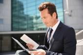 Businessman working on laptop computer — Stock Photo