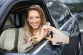 Woman holding brand new car keys — Stock Photo