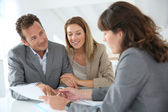 Couple meeting financial adviser — Stock Photo