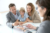 Family signing home purchase contract — Stock Photo