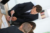 Manager having meeting with business team — Stock Photo